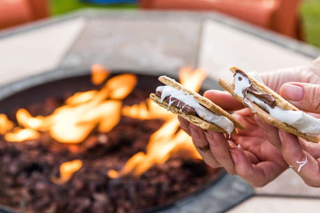 Holding S'mores over grill